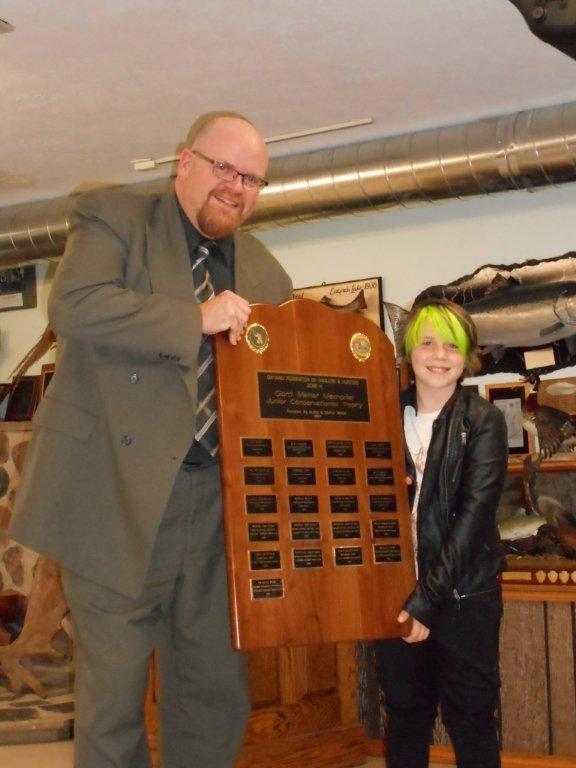 OFAH Zone H Awards Chairman Jason Forgrave (L) presents The Gord Maher Memorial Junior Conservation Trophy for the second year in a row to Megan Reid from the Barrie District